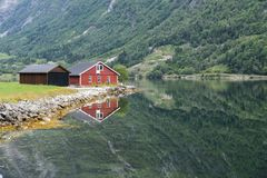 Red wooden house at norway fjord Stock Images
