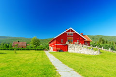 Red wooden house Stock Photos