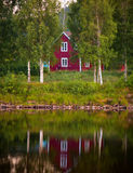 Red wooden house in Sweden Stock Photos