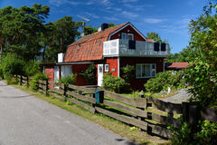 Red wooden house in Sweden Stock Image