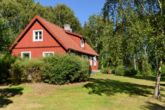 Red wooden house in Sweden Royalty Free Stock Photography