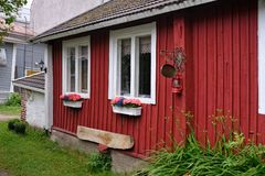 Red wooden house. Traditional red wooden house at rainy day. Tammisaari, Finland stock images