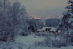 Red wooden house in winter landscape Royalty Free Stock Photography