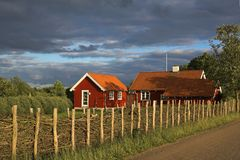 Red wooden houses. Behind a wooden fence Stock Images