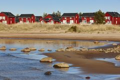 Red wooden houses near Marjaniemi beach, Hailuoto island. Finlan Royalty Free Stock Photos