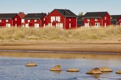 Red wooden houses near Marjaniemi beach, Hailuoto island. Finlan Royalty Free Stock Photo