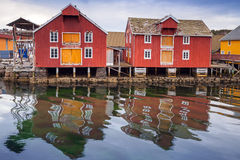 Red wooden houses in Norwegian fishing village. Red and yellow wooden houses in Norwegian fishing village stock photography