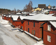 Red wooden houses in Porvoo, Finland. Red wooden houses on the river coast in Porvoo town, Finland (winter season Royalty Free Stock Images