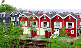 Red wooden houses. On the shore of the North Sea Stock Image