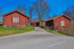Red wooden houses. Traditional red ochre painted colour wooden houses at Fagervik Ironworks works street, Finland. Most of the surviving huts date to the Stock Images