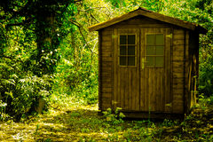 Red wooden hunting lodge in the deep forest royalty free stock photo