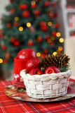 Red wooden lantern under fir-tree Stock Images