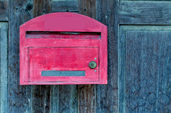 Red wooden mail box on grunge wooden wall Royalty Free Stock Photography