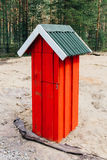 Red wooden mailbox in the village. Daytime photo Royalty Free Stock Photo