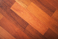 Red wooden parquet made of African pear Stock Photos