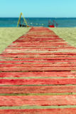 Red wooden path to the sea Stock Image