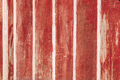 Red wooden planks. Red planks form part of a fence in Bali Indonesia Stock Photography