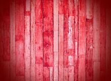 Red wooden planks. Red latticework connected to the wall Stock Image