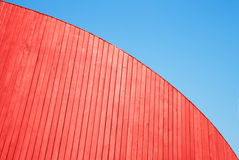 Red wooden planks wall and blue sky Stock Photo