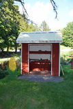 Red Wooden Produce Stand on Farm. A red wooden produce stand sits in the yard of a country farm Royalty Free Stock Photos