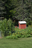 Red Wooden Produce Stand and Garden Stock Photos