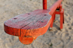 Red wooden seesaw playground Stock Images
