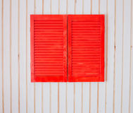 Red wooden shutters on a white wall Royalty Free Stock Photos