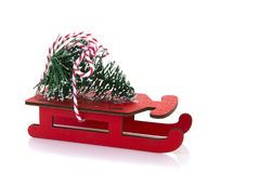 Red Wooden sled with Chrisstmas Tree Stock Photos