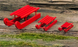 Red wooden sled, fleet. On wood Stock Photo