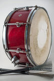 Red Wooden snare drum and Jazz brushes isolated on a white backg Stock Photo