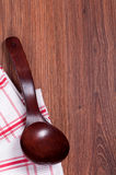 Red wooden spoon on a napkin in a cage Royalty Free Stock Photos