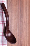 Red wooden spoon with a red cloth Royalty Free Stock Image