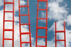 Several Red Stairways To Heaven. The Road To Success. Achievement Of Goals Career Concept royalty free stock photos
