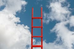 Red Stairway To Heaven in Center. The Road To Success. Achievement Of Goals Career Concept. A red wooden staircase against a blue cloud of a symbol of success royalty free stock image
