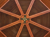 Red wooden structure in a roof with golden parts Stock Image