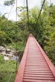 Red wooden suspension bridge Stock Photos