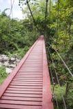Red wooden suspension bridge Royalty Free Stock Image