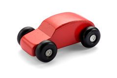 Red wooden toy car. On white background with natural shadow Stock Image