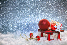 Red wooden toy sleigh, gift box, ball, Stock Photo