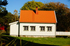 Red wooden traditional house, Norway Royalty Free Stock Image