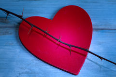 Red wooden valentines heart and thorn abstract pain Royalty Free Stock Photos