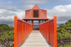 Red wooden viewpoint pathway in Pico island vineyard. Azores. Po Stock Photo