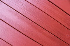 Red wooden wall. Wall made of wooden plank. painted red Royalty Free Stock Photos