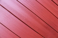 Red wooden wall. Wall made of wooden plank. painted red Stock Photos