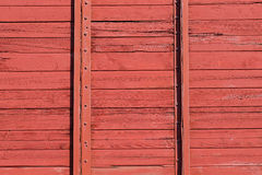 Red wooden wall of railroad wagon. Background pattern.  Stock Photo