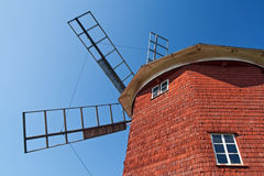 Red wooden windmill. With windows, against the blue sky Stock Images