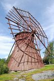 Red Wooden Windmill. Uncommon ancient red wooden windmill in Western Finland Royalty Free Stock Images