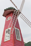 Red wooden windmill building. In retro style Stock Image