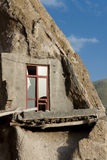 Red wooden window - Candovan. Small one wooden window in rocks house in Candovan - Iran Stock Photography