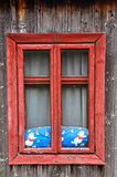 Red wooden window on a rustic house Stock Photos